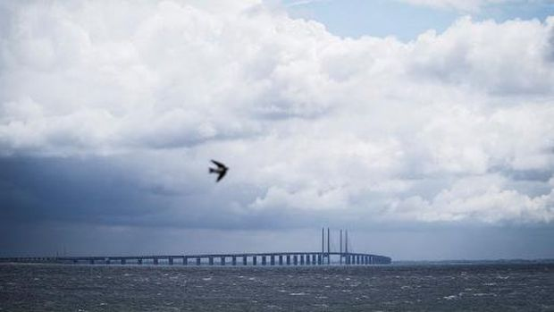 A picture taken on June 30, 2020 in Copenhagen, shows a view of the Oresund Bridge, which connects Denmark and Sweden (Copenhagen and Malm). - The 20th anniversary of the bridge will be marked on July 1, 2020. (Photo by Niels Christian Vilmann / Ritzau Scanpix / AFP) / Denmark OUT