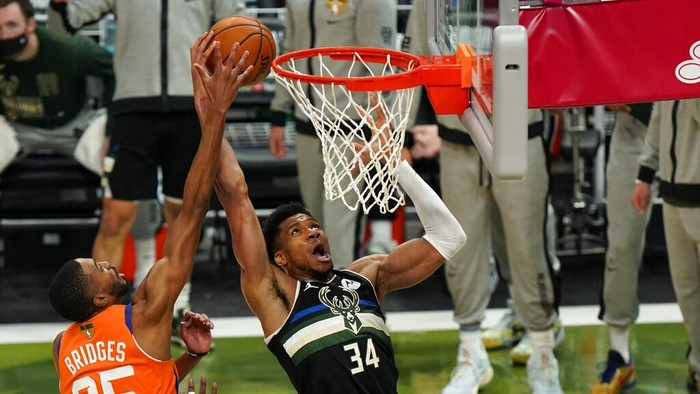 Milwaukee Bucks forward Giannis Antetokounmpo (34) goes to the basket against Phoenix Suns forward Mikal Bridges (25) during the second half of Game 6 of basketballs NBA Finals in Milwaukee, Tuesday, July 20, 2021. (AP Photo/Paul Sancya)