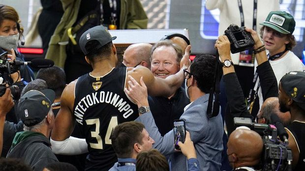 Milwaukee Bucks head coach Mike Budenholzer watches form the bench during the first half of Game 6 of basketball's NBA Finals against the Phoenix Suns in Milwaukee, Tuesday, July 20, 2021. (AP Photo/Paul Sancya)