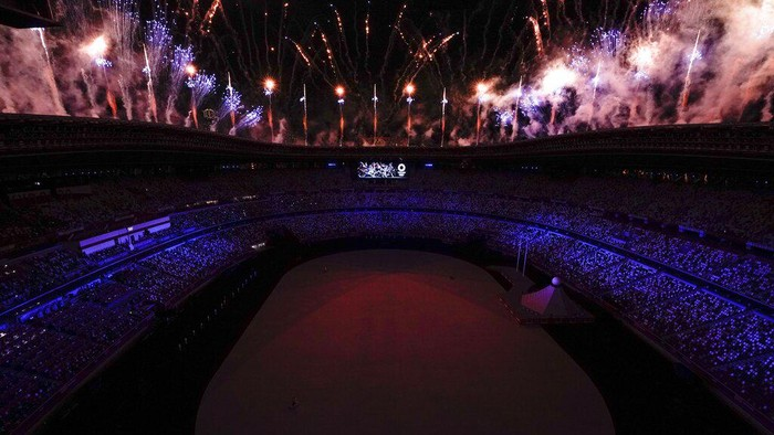 Fireworks go off at the start of the opening ceremony in the Olympic Stadium at the 2020 Summer Olympics, Friday, July 23, 2021, in Tokyo.