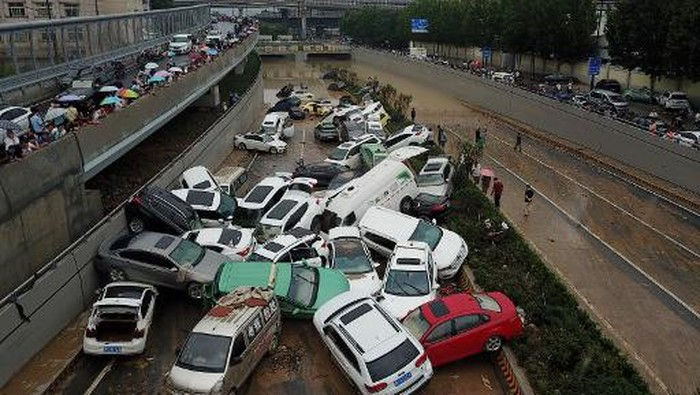 An aerial view shows cars sitting in floodwaters at the entrance of a tunnel after heavy rains hit the city of Zhengzhou in Chinas central Henan province on July 22, 2021. (Photo by Noel Celis / AFP)