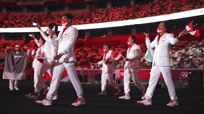 Team Indonesia during the opening ceremony in the Olympic Stadium at the 2020 Summer Olympics, Friday, July 23, 2021, in Tokyo, Japan. (Hannah McKay/Pool Photo via AP)