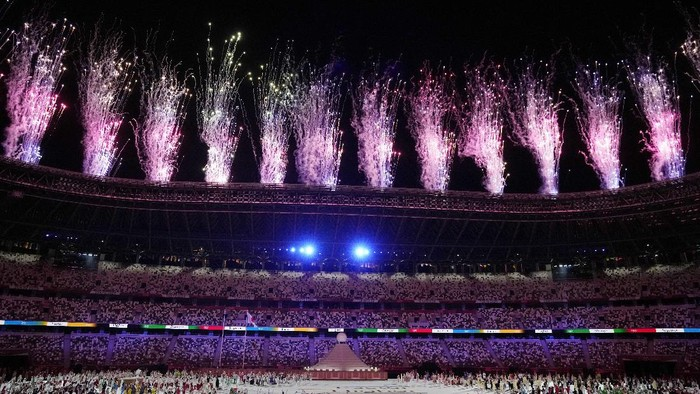 Fireworks explode during the opening ceremony in the Olympic Stadium at the 2020 Summer Olympics, Friday, July 23, 2021, in Tokyo, Japan. (AP Photo/Kirsty Wigglesworth)