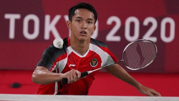 Indonesia's Jonathan Christie plays against Aram Mahmoud of the Refugee Olympic Team during their men's singles badminton match at the 2020 Summer Olympics, Saturday, July 24, 2021, in Tokyo, Japan. (AP Photo/Dita Alangkara)
