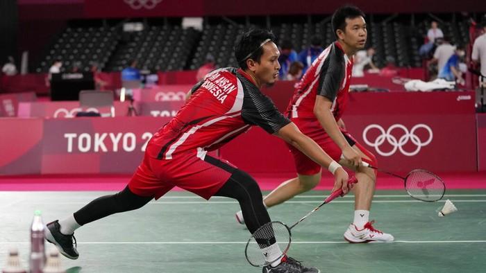 Mohammad Ashsan, left, and Hendra Setiawan of Indonesia compete against Canadian Nyl Yakura and Jason Ho-Shue during mens double Badminton match at the 2020 Summer Olympics, Saturday, July 24, 2021, in Tokyo, Japan. (AP Photo/Dita Alangkara)