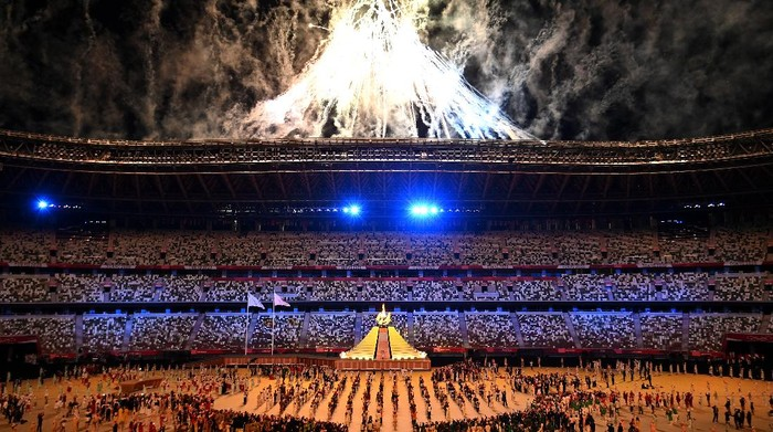 TOKYO, JAPAN - JULY 23: General view inside the stadium as fireworks go off while Naomi Osaka of Team Japan lights the Olympic cauldron with the Olympic torch during the Opening Ceremony of the Tokyo 2020 Olympic Games at Olympic Stadium on July 23, 2021 in Tokyo, Japan. (Photo by Dylan Martinez - Pool/Getty Images)