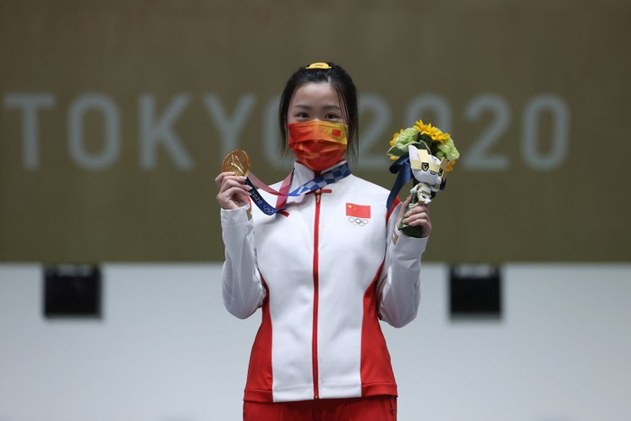 ASAKA, JAPAN - JULY 24: Gold Medalist Qian Yang of Team China poses on the podium during the medal ceremony for the 10m Air Rifle Womens event on day one of the Tokyo 2020 Olympic Games at Asaka Shooting Range on July 24, 2021 in Asaka, Saitama, Japan. (Photo by Kevin C. Cox/Getty Images)