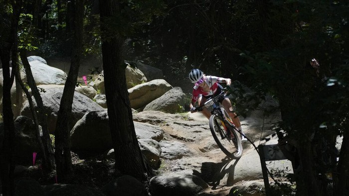 Jolanda Neff of Switzerland rides during a training for the Mountain Bike Cycling race at the 2020 Summer Olympics, Friday, July 23, 2021, in Izu, Japan. (AP Photo/Christophe Ena)
