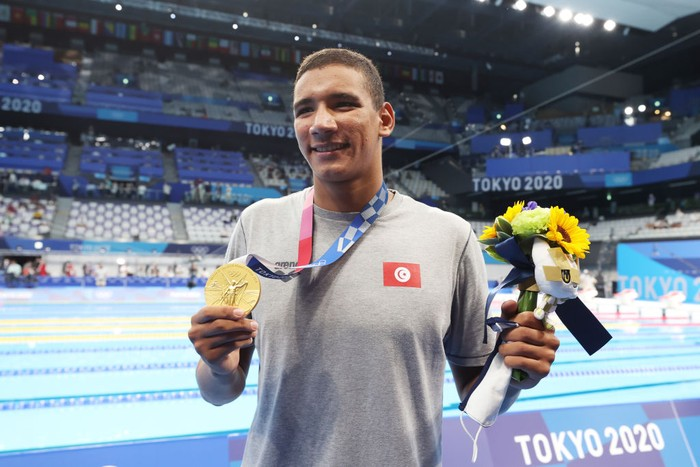 TOKYO, JAPAN - JULY 25: Ahmed Hafnaoui of Team Tunisia poses with the gold medal for the Mens 400m Freestyle Final on day two of the Tokyo 2020 Olympic Games at Tokyo Aquatics Centre on July 25, 2021 in Tokyo, Japan. (Photo by Al Bello/Getty Images)