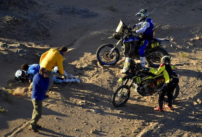 Frances biker Adrien Van Beveren lies on the sand after a crash during the Stage 3 of the Dakar 2020 around Neom, Saudi Arabia, on January  7, 2020. (Photo by FRANCK FIFE / AFP)