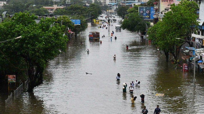 Flooding is common during Indias monsoon season but climate change is making the monsoon stronger, according to a report from the Potsdam Institute for Climate Impact Research INDRANIL MUKHERJEE AFP/File