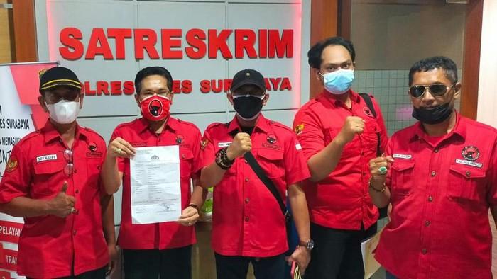 BBHAR PDIP Surabaya menunjukkan surat laporan dari Polrestabes Surabaya
