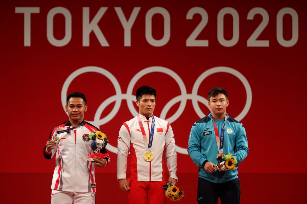 OYAMA, JAPAN - JULY 24: (L-R) Silver medalist Wout van Aert of Team Belgium, gold medalist Richard Carapaz of Team Ecuador, and bronze medalist Tadej Pogacar of Team Slovenia, pose on the podium during the medal ceremony during the Men's road race at the Fuji International Speedway on day one of the Tokyo 2020 Olympic Games on July 24, 2021 in Oyama, Shizuoka, Japan. (Photo by Tim de Waele/Getty Images)