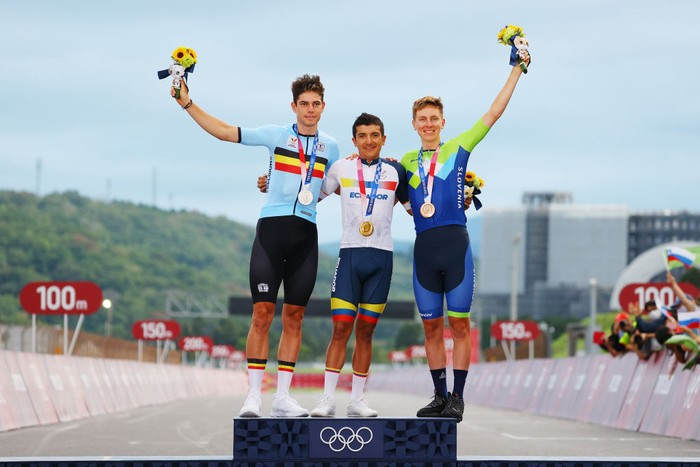 OYAMA, JAPAN - JULY 24: (L-R) Silver medalist Wout van Aert of Team Belgium, gold medalist Richard Carapaz of Team Ecuador, and bronze medalist Tadej Pogacar of Team Slovenia, pose on the podium during the medal ceremony during the Mens road race at the Fuji International Speedway on day one of the Tokyo 2020 Olympic Games on July 24, 2021 in Oyama, Shizuoka, Japan. (Photo by Tim de Waele/Getty Images)