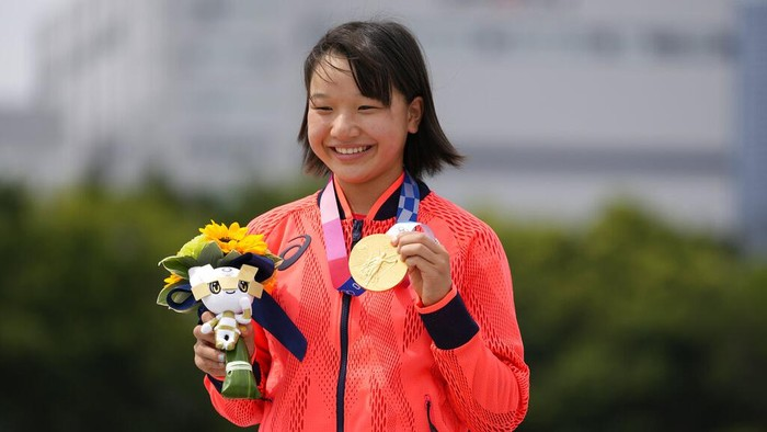 Gold medal winner Momiji Nishiya of Japan holds her medal after winning the womens street skateboarding finals at the 2020 Summer Olympics, Monday, July 26, 2021, in Tokyo, Japan. (AP Photo/Ben Curtis)