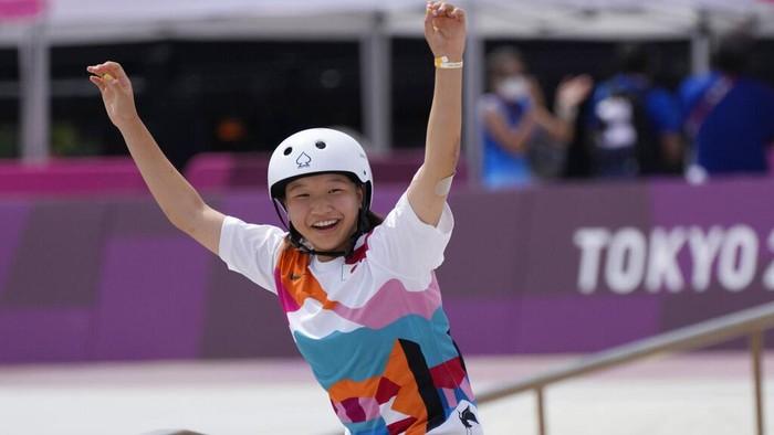 Gold medal winner Momiji Nishiya of Japan smiles after winning the womens street skateboarding finals at the 2020 Summer Olympics, Monday, July 26, 2021, in Tokyo, Japan. (AP Photo/Ben Curtis)