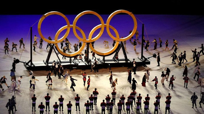 TOKYO, JAPAN - JULY 23: Performers dance around a large Olympic Rings logo during the Opening Ceremony of the Tokyo 2020 Olympic Games at Olympic Stadium on July 23, 2021 in Tokyo, Japan. (Photo by Cameron Spencer/Getty Images)