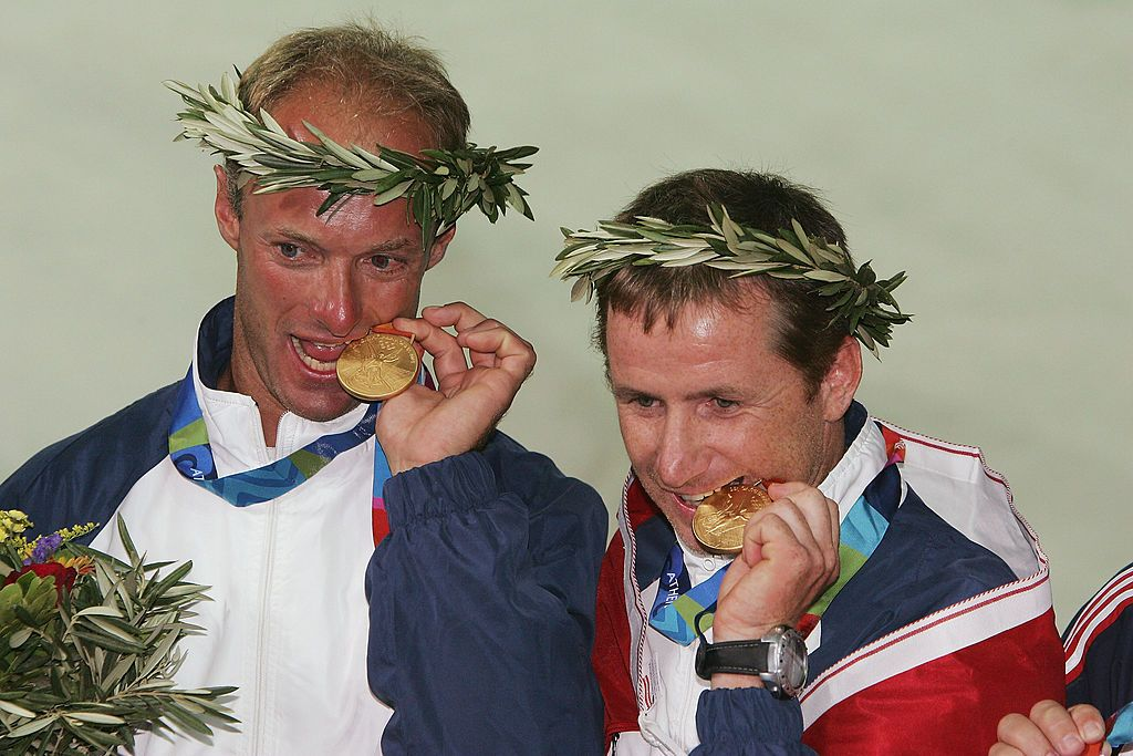 ATHENS - AUGUST 28:  Hans Peter Steinarcher (left) and Roman Hagara of Austria receive the gold medals for the open multihull tornado event on August 28, 2004 during the Athens 2004 Summer Olympic Games at Agios Kosmas Olympic Sailing Centre in Athens, Greece. (Photo by Ben Radford/Getty Images)