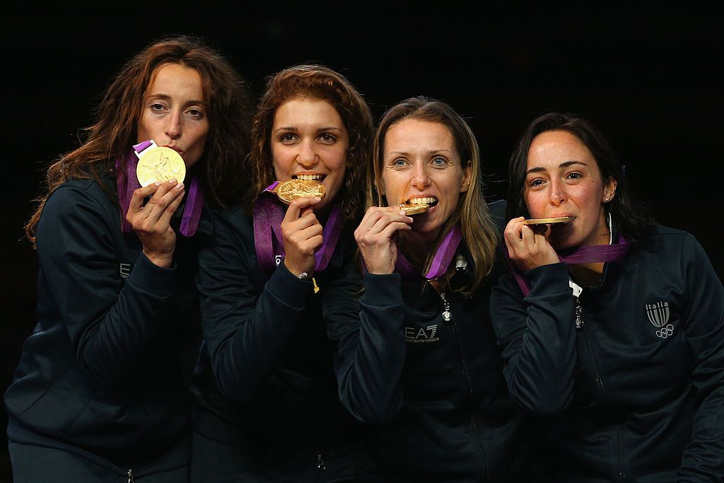 LONDON, ENGLAND - AUGUST 02:  Ilaria Salvatori, Arianna Errigo, Valentina Vezzali and Elisa Di Francisca of Italy celebrate with their gold medals during the medal ceremony after the Women's Foil Team Fencing gold medal match on Day 6 of the London 2012 Olympic Games at ExCeL on August 2, 2012 in London, England. Russia won silver and Korea won bronze.  (Photo by Hannah Peters/Getty Images)