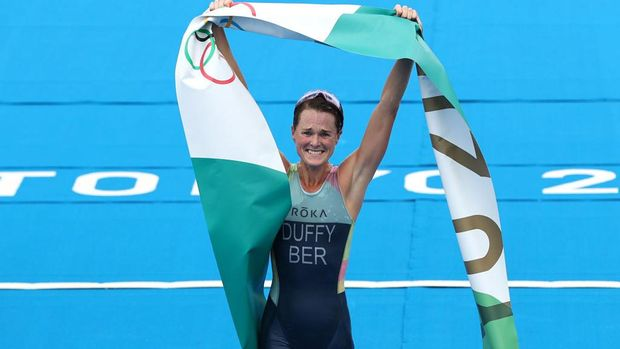 TOKYO, JAPAN - JULY 27:  Flora Duffy of Team Bermuda celebrates winning the gold medal during the Women's Individual Triathlon on day four of the Tokyo 2020 Olympic Games at Odaiba Marine Park on July 27, 2021 in Tokyo, Japan. (Photo by Cameron Spencer/Getty Images)