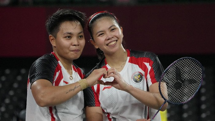 Indonesias Greysia Polii and Rahayu Apriani celebrate after winning against Japans Yuki Fukushima and Sayaka Hirota during their womens doubles group play stage badminton match at the 2020 Summer Olympics, Tuesday, July 27, 2021, in Tokyo, Japan. (AP Photo/Markus Schreiber)
