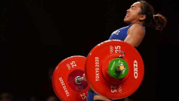 Hidilyn Diaz of Philippines celebrates with Weightlifting Philippines federation president Monico Puntuevella after winning the gold medal in the women's 55kg weightlifting event, at the 2020 Summer Olympics, Monday, July 26, 2021, in Tokyo, Japan. (AP Photo/Luca Bruno)