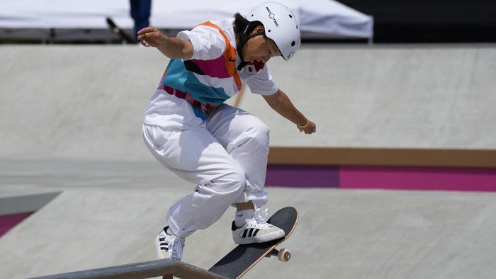 Momiji Nishiya of Japan, who won the gold medal, competes in the women's street skateboarding finals at the 2020 Summer Olympics, Monday, July 26, 2021, in Tokyo, Japan. (AP Photo/Ben Curtis)