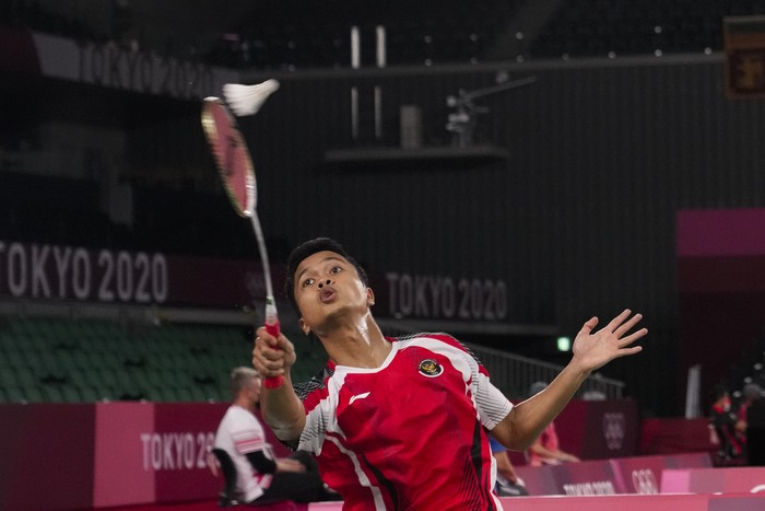 Indonesias Anthony Sinisuka Ginting competes against Hungarys Gergely Krausz during their mens singles badminton match at the 2020 Summer Olympics, Sunday, July 25, 2021, in Tokyo, Japan. (AP Photo/Markus Schreiber)