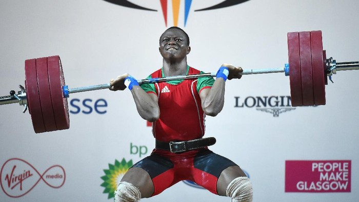 GLASGOW, SCOTLAND - JULY 28: Cyrille Tchatchet of Cameroon competes in the mens 85kg weightlifting at the Clyde Auditorium during day five of the Glasgow 2014 Commonwealth Games on July 28, 2014 in Glasgow, United Kingdom.  (Photo by Jeff J Mitchell/Getty Images)