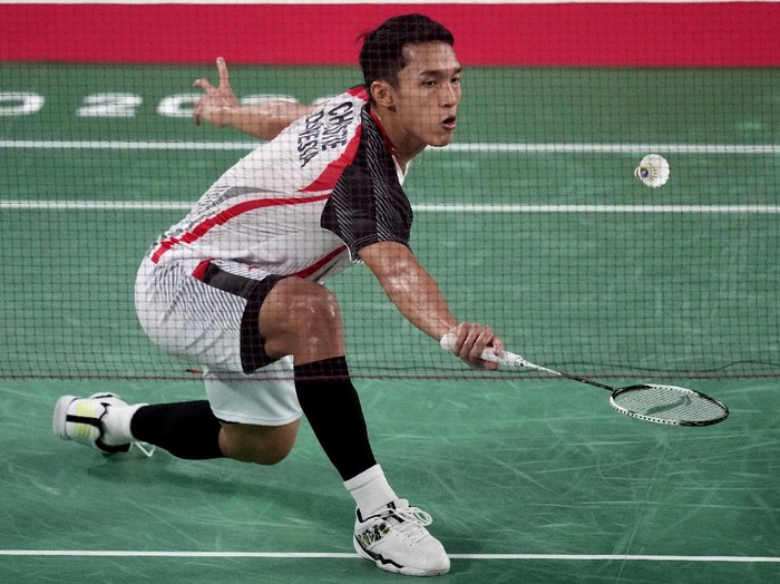 Jonatan Christie of Indonesia competes against Singapores Kean Yew Loh during mens singles group play stage Badminton match at the 2020 Summer Olympics, Wednesday, July 28, 2021, in Tokyo, Japan. (AP Photo/Dita Alangkara)