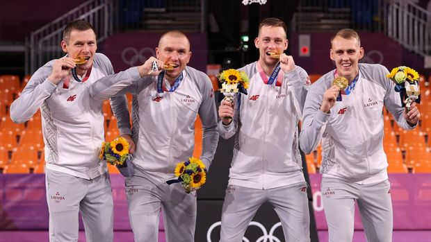 TOKYO, JAPAN - JULY 28: Gold medalists Nauris Miezis, Karlis Lasmanis, Edgars Krumins and Agnis Cavars of Team Latvia pose with their gold medals for the 3x3 Basketball competition on day five of the Tokyo 2020 Olympic Games at Aomi Urban Sports Park on July 28, 2021 in Tokyo, Japan. (Photo by Christian Petersen/Getty Images)