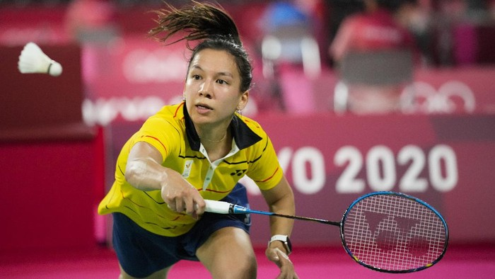 Belgiums Lianne Tan plays against Indonesias Gregoria Mariska Tunjung during their womens singles group stage badminton match at the 2020 Summer Olympics, Wednesday, July 28, 2021, in Tokyo, Japan. (AP Photo/Dita Alangkara)
