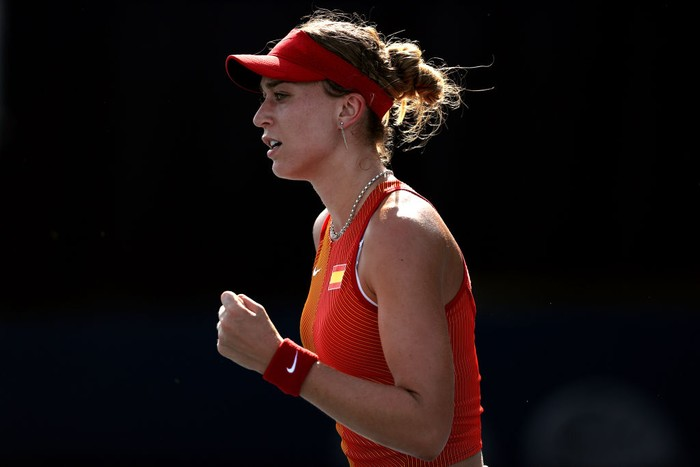 TOKYO, JAPAN - JULY 24: Paula Badosa of Team Spain celebrates victory after her Womens Singles First Round match against Kristina Mladenovic of Team France on day one of the Tokyo 2020 Olympic Games at Ariake Tennis Park on July 24, 2021 in Tokyo, Japan. (Photo by Clive Brunskill/Getty Images)