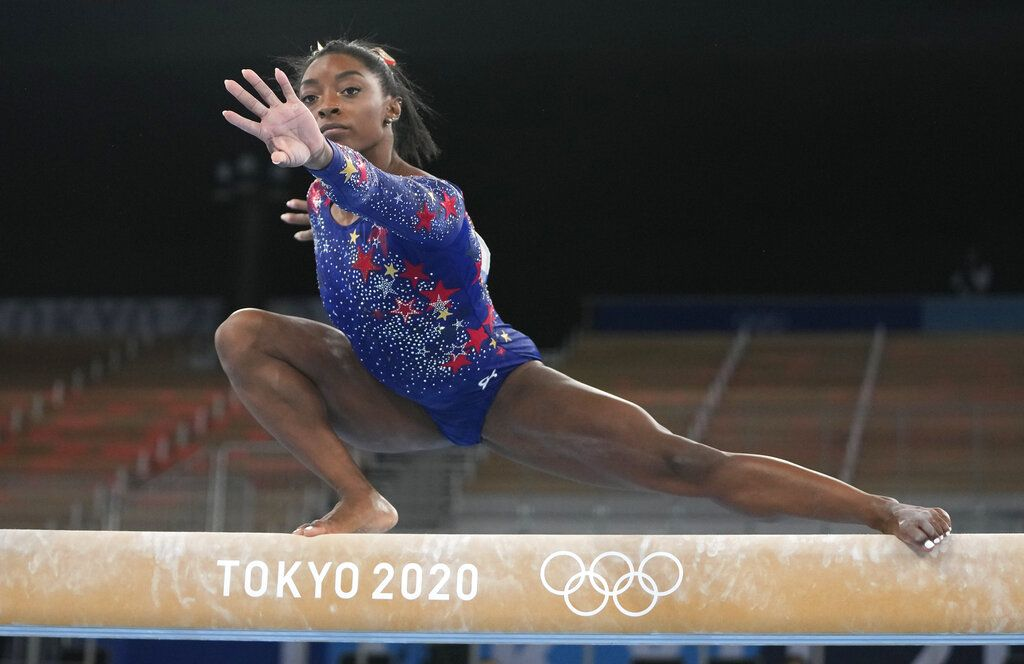 Simone Biles, of United States, performs on the vault during women's artistic gymnastic qualifications at the 2020 Summer Olympics, Sunday, July 25, 2021, in Tokyo. (AP Photo/Morry Gash)