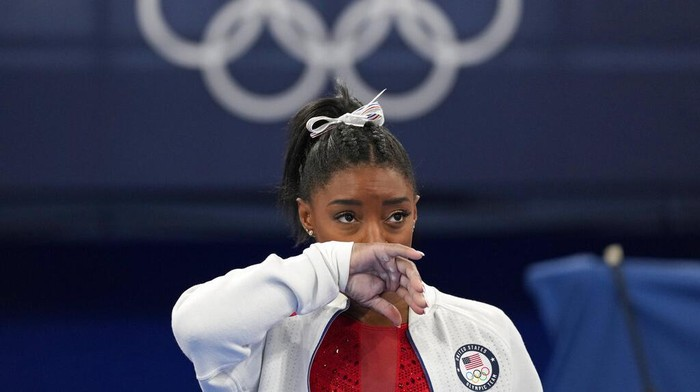 Simone Biles, of United States, performs on the vault during womens artistic gymnastic qualifications at the 2020 Summer Olympics, Sunday, July 25, 2021, in Tokyo. (AP Photo/Morry Gash)
