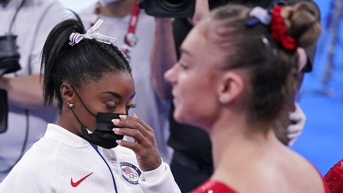 Simone Biles, of the United States, waits to perform on the vault during the artistic gymnastics womens final at the 2020 Summer Olympics, Tuesday, July 27, 2021, in Tokyo. The American gymnastics superstar has withdrawn the all-around competition to focus on her mental well-being. (AP Photo/Gregory Bull)