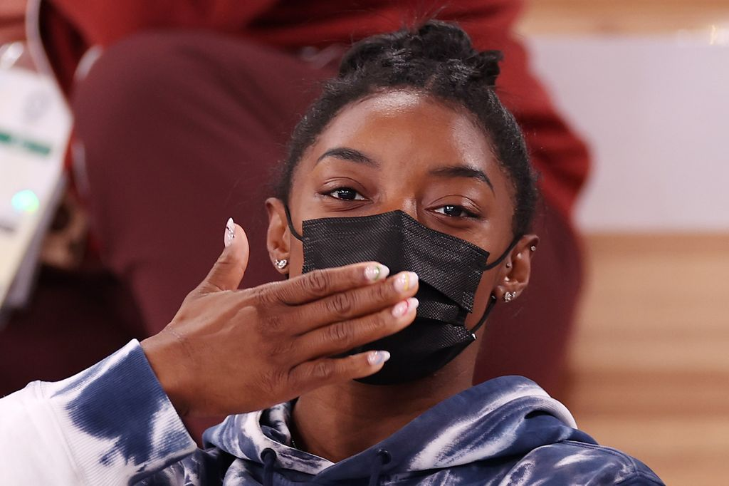 TOKYO, JAPAN - JULY 28: Simone Biles of Team United States blows a kiss whilst watching the Men's All-Around Final on day five of the Tokyo 2020 Olympic Games at Ariake Gymnastics Centre on July 28, 2021 in Tokyo, Japan. (Photo by Jamie Squire/Getty Images)