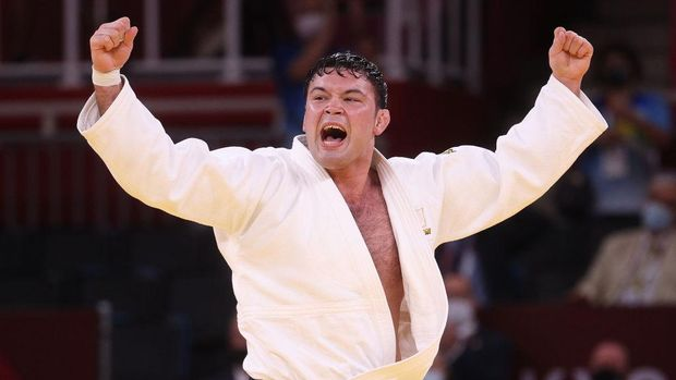 TOKYO, JAPAN - JULY 29: Aaron Wolf of Team Japan reacts after defeating Guham Cho of Team Republic of Korea during the Men's Judo 100kg Final on day six of the Tokyo 2020 Olympic Games at Nippon Budokan on July 29, 2021 in Tokyo, Japan. (Photo by Chris Graythen/Getty Images)
