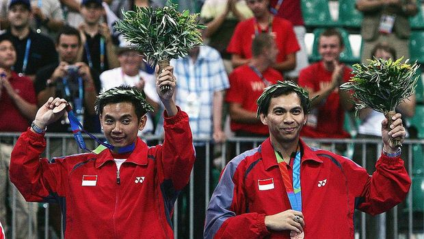ATHENS - AUGUST 20:  Eng Hian and Flandy Limpele of Indonesia Bronze medal winners stand on the podium after the men's doubles badminton medal ceremony on August 20, 2004 during the Athens 2004 Summer Olympic Games at Olympic Hall in the Goudi Olympic Complex in Athens, Greece. (Photo by Ben Radford/Getty Images)