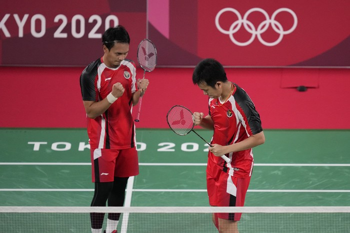 Indonesias Mohammad Ahsan and Hendra Setiawan celebrate after defeating Japans Takeshi Kamura and Keigo Sonoda during their mens doubles quarterfinal matchat the 2020 Summer Olympics, Thursday, July 29, 2021, in Tokyo, Japan. (AP Photo/Dita Alangkara)