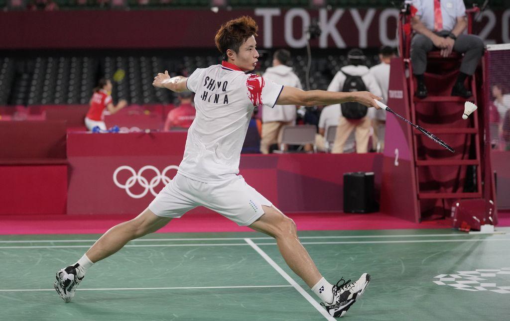 Jonatan Christie of Indonesia competes China's Yu Qi Shi during men's singles round Badminton match at the 2020 Summer Olympics, Thursday, July 29, 2021, in Tokyo, Japan. (AP Photo/Dita Alangkara)