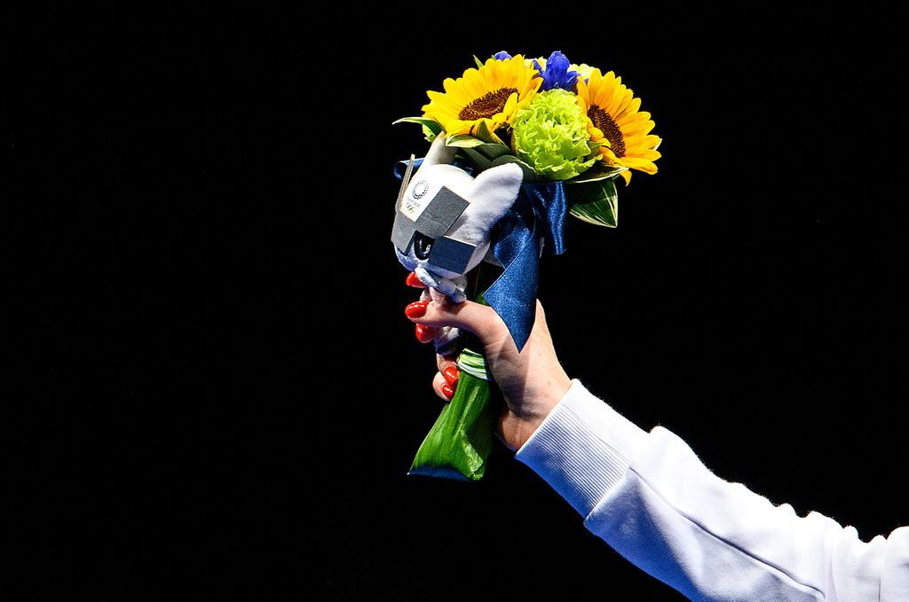 CHIBA, JAPAN - JULY 25: Silver medalist Inna Deriglazova of Team ROC poses with flowers in her hand on the podium during the medal ceremony for the Women's Foil Individual Fencing Gold Medal event on day two of the Tokyo 2020 Olympic Games at Makuhari Messe Hall on July 25, 2021 in Chiba, Japan. (Photo by Matthias Hangst/Getty Images,)