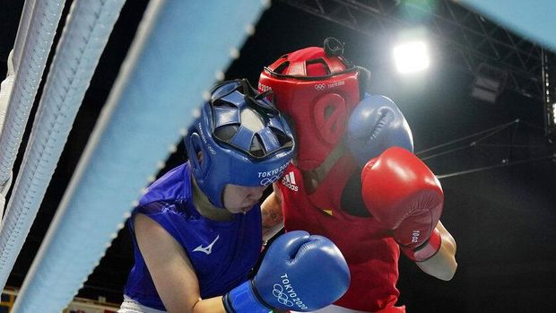 Japan's Sena Irie reacts after winning her women's featherweight 57-kg boxing match against Romania's Maria Nechita at the 2020 Summer Olympics, Wednesday, July 28, 2021, in Tokyo, Japan. (AP Photo/Frank Franklin II, Pool)