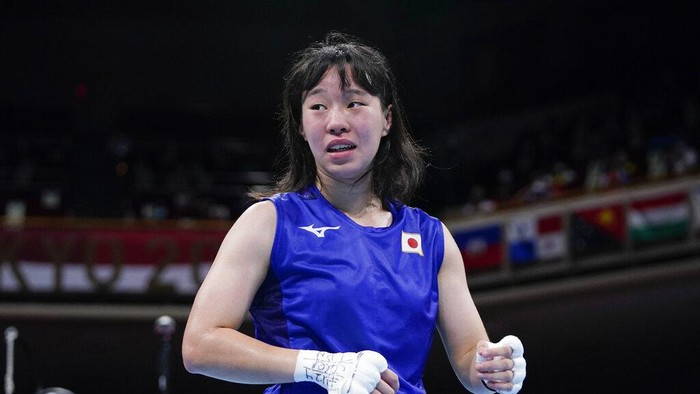 Japans Sena Irie reacts after winning her womens featherweight 57-kg boxing match against Romanias Maria Nechita at the 2020 Summer Olympics, Wednesday, July 28, 2021, in Tokyo, Japan. (AP Photo/Frank Franklin II, Pool)