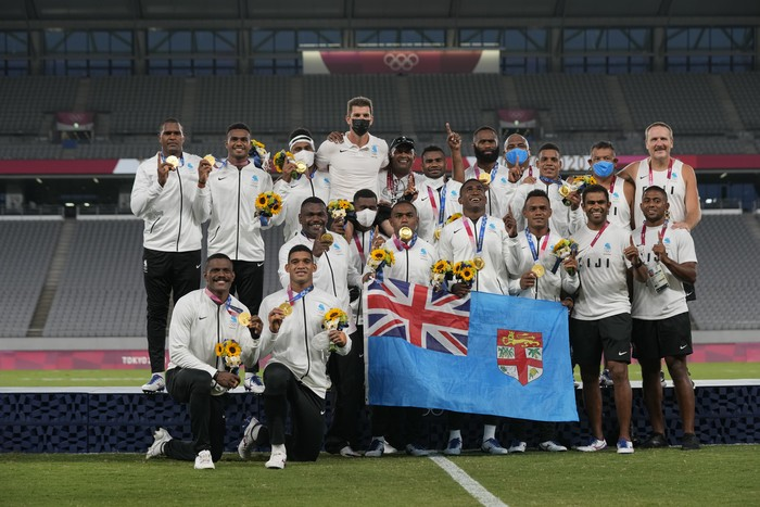Fijis team poses with their gold medals after winning mens rugby sevens at the 2020 Summer Olympics, Wednesday, July 28, 2021 in Tokyo, Japan. (AP Photo/Shuji Kajiyama)