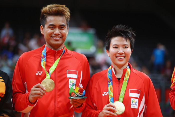 RIO DE JANEIRO, BRAZIL - AUGUST 17:  Gold medalists, Tontowi Ahmad and Liliyana Natsir of Indonesia celebrate after the Mixed Doubles Gold Medal Match on Day 12 of the Rio 2016 Olympic Games at Riocentro - Pavilion 4 on August 17, 2016 in Rio de Janeiro, Brazil.  (Photo by Dean Mouhtaropoulos/Getty Images)