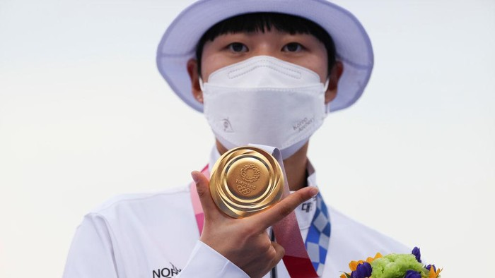 TOKYO, JAPAN - JULY 30: San An of Team South Korea poses with the gold medal for the archery Women's Individual competition on day seven of the Tokyo 2020 Olympic Games at Yumenoshima Park Archery Field on July 30, 2021 in Tokyo, Japan. (Photo by Justin Setterfield/Getty Images)