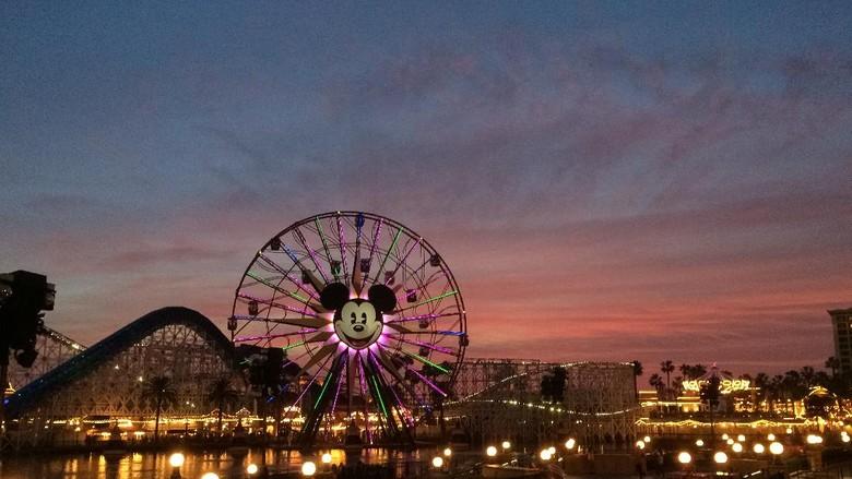 Anahiem, California, USA - December 21, 2014: Tourists wander around Disneys California Adventure at dusk. California Adventure is a park located adjacent to Disneyland, a major tourist attraction in Anaheim.