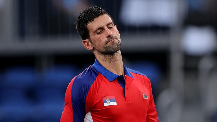 TOKYO, JAPAN - JULY 30: Novak Djokovic of Team Serbia reacts after a point during his Mens Singles Semifinal match against Alexander Zverev of Team Germany on day seven of the Tokyo 2020 Olympic Games at Ariake Tennis Park on July 30, 2021 in Tokyo, Japan. (Photo by Clive Brunskill/Getty Images)
