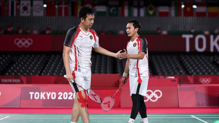 CHOFU, JAPAN - JULY 30: Mohammad Ahsan(right) and Hendra Setiawan of Team Indonesia react as they competes against Lee Yang and Wang Chi-lin of Team Chinese Taipei during a Men's Doubles Semi-final match on day seven of the Tokyo 2020 Olympic Games at Musashino Forest Sport Plaza on July 30, 2021 in Chofu, Tokyo, Japan. (Photo by Lintao Zhang/Getty Images)